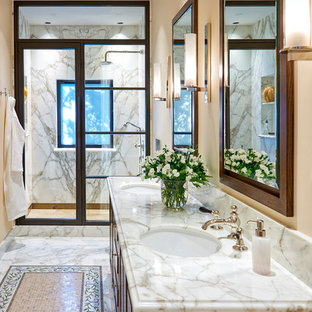 Design ideas for a large mediterranean ensuite bathroom in San Francisco with medium wood cabinets, an alcove shower, white tiles, marble tiles, beige walls, marble flooring, a submerged sink, marble worktops, white floors, a hinged door, white worktops and raised-panel cabinets.