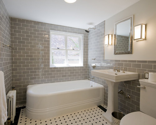 traditional subway tile and gray tile corner bathtub idea in new york with a pedestal sink - Bathroom Gray Subway Tile