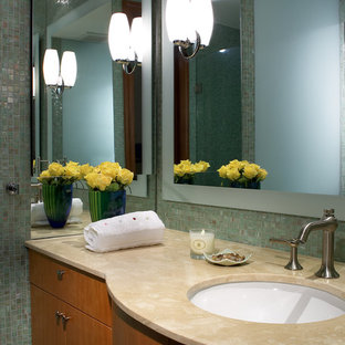 Mid-sized minimalist 3/4 multicolored tile and mosaic tile marble floor and white floor bathroom photo in Miami with furniture-like cabinets, medium tone wood cabinets, a one-piece toilet, multicolored walls, an undermount sink and marble countertops