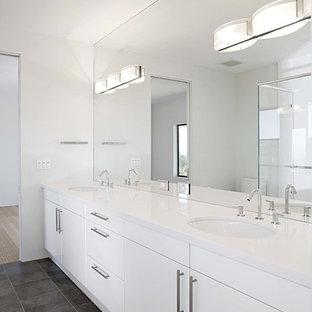 Idées déco pour une salle de bain contemporaine avec un lavabo encastré et un mur blanc.