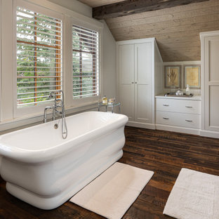 Photo of a mid-sized country master bathroom in Other with shaker cabinets, white cabinets, a freestanding tub, white walls, white benchtops, a single vanity, a built-in vanity and wood.