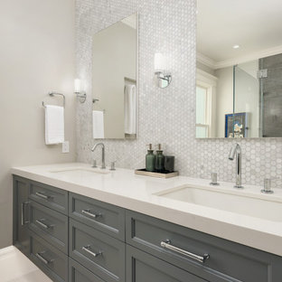 Walk-in shower - large transitional master gray tile and marble tile ceramic tile and beige floor walk-in shower idea in San Francisco with beaded inset cabinets, gray cabinets, a one-piece toilet, gray walls, an undermount sink, quartz countertops and a hinged shower door