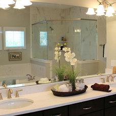Beach Style Bathroom by Corner Lot Custom Homes
