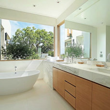 Midcentury Bathroom by Building Solutions and Design, Inc
