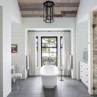Beach style master marble floor and pink floor bathroom photo in Charleston with white cabinets, white walls, an undermount sink, marble countertops and white countertops