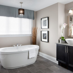 Inspiration for a transitional freestanding bathtub remodel in Toronto with a vessel sink