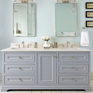 Inspiration for a timeless master white floor bathroom remodel in Toronto with gray cabinets, blue walls, white countertops, recessed-panel cabinets and an undermount sink