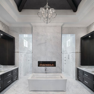 Classic ensuite bathroom in Miami with shaker cabinets, dark wood cabinets, a freestanding bath, grey walls, marble flooring, a built-in sink, marble worktops, a walk-in shower, grey tiles, white tiles and an open shower.