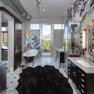 This is an example of a contemporary ensuite bathroom in Miami with freestanding cabinets, black cabinets, black and white tiles, multi-coloured walls, marble flooring, a submerged sink and marble worktops.
