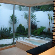 Tropical Bathroom by Aple Const