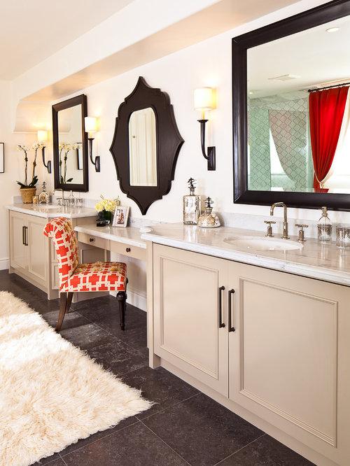 Das Bad Design mit Badewanne und Feuerstelle lädt zum Enspannen ein