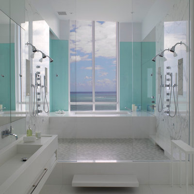 Double shower - contemporary double shower idea in Miami with an integrated sink