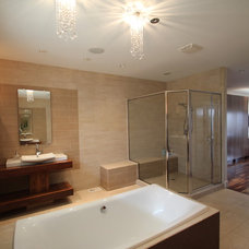 Modern Bathroom by Jerry Bussanmas