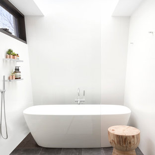 Photo of a mid-sized modern master bathroom in Melbourne with a freestanding tub, white walls, porcelain floors, an open shower, a curbless shower and grey floor.