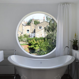 Elegant claw-foot bathtub photo in London with white walls