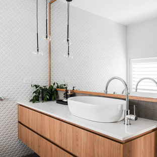 This is an example of a contemporary bathroom in Hobart with flat-panel cabinets, medium wood cabinets, white walls, a vessel sink and grey floor.