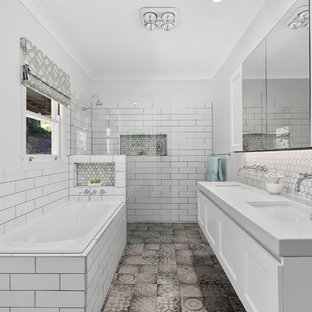 Inspiration for a transitional master bathroom in Brisbane with shaker cabinets, white cabinets, a drop-in tub, a curbless shower, white tile, subway tile, grey walls, an undermount sink, grey floor, an open shower and grey benchtops.