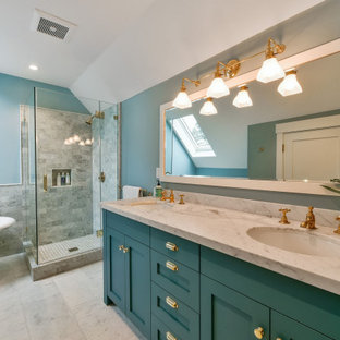 Bathroom - traditional gray tile white floor bathroom idea in San Francisco with shaker cabinets, turquoise cabinets, blue walls, an undermount sink, a hinged shower door and white countertops