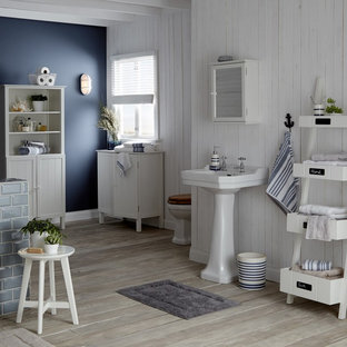 Inspiration for a nautical bathroom in London with grey floors.