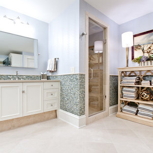 Huge coastal kids' glass tile travertine floor corner shower photo in Atlanta with an undermount sink, raised-panel cabinets, white cabinets, concrete countertops, a two-piece toilet and blue walls