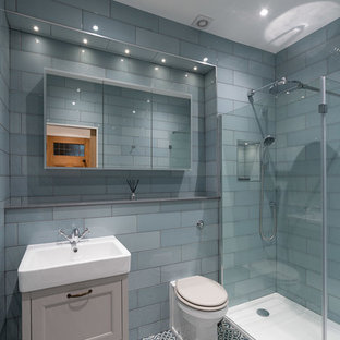 Design ideas for a traditional shower room bathroom in Glasgow with recessed-panel cabinets, beige cabinets, a corner shower, a one-piece toilet, blue tiles, a wall-mounted sink and multi-coloured floors.