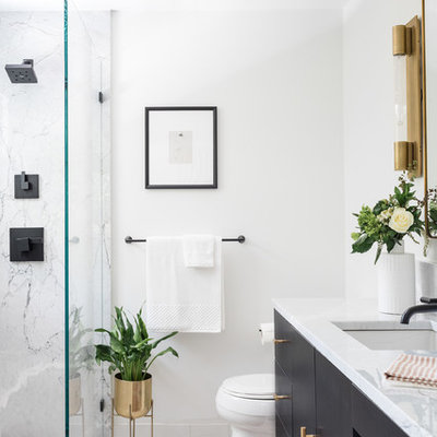 Bathroom - mid-sized contemporary 3/4 marble tile, gray tile and white tile white floor bathroom idea in Boston with flat-panel cabinets, black cabinets, a one-piece toilet, white walls, an undermount sink, marble countertops and gray countertops