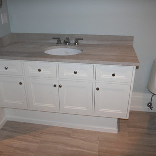 Inspiration for a mid-sized timeless 3/4 porcelain tile and multicolored floor bathroom remodel in Orange County with shaker cabinets, white cabinets, a one-piece toilet, blue walls, an undermount sink and stainless steel countertops