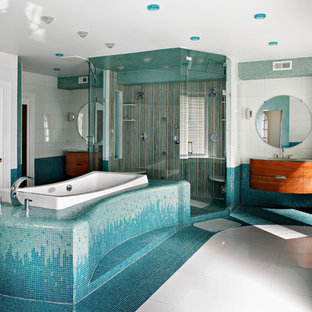 Design ideas for a large midcentury ensuite bathroom in Philadelphia with mosaic tiles, blue tiles, flat-panel cabinets, dark wood cabinets, a built-in bath, an alcove shower, white walls, mosaic tile flooring, a submerged sink, glass worktops, white floors and a hinged door.