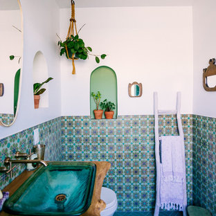 Mediterranean bathroom in San Francisco with a shower/bath combination, green tiles, ceramic tiles, white walls, ceramic flooring, a pedestal sink, wooden worktops, green floors and an open shower.