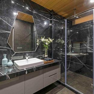 Ispirazione per una stanza da bagno design con ante lisce, ante beige, doccia ad angolo, pareti grigie, lavabo a bacinella, porta doccia scorrevole, top grigio e pavimento marrone