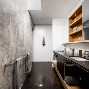 Inspiration for a modern master bathroom in Perth with flat-panel cabinets, black cabinets, white walls, concrete floors, an undermount sink, black floor and black benchtops.