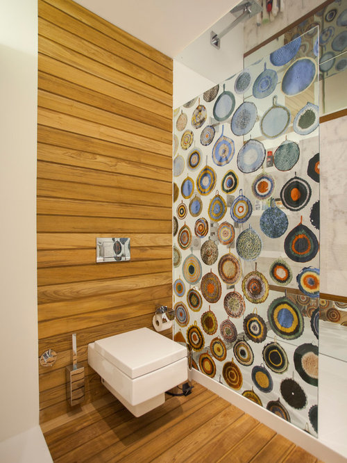 inspiration for a contemporary bathroom remodel in other with an alcove shower and a wall