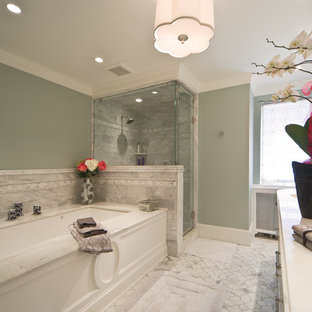 Photo of a large classic ensuite bathroom in DC Metro with a submerged sink, white cabinets, a submerged bath, a corner shower, grey tiles, marble tiles, green walls, marble flooring, marble worktops, white floors and a hinged door.