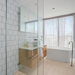 На фото: маленькая главная ванная комната в стиле модернизм с открытым душем, белой плиткой, керамогранитной плиткой, белыми стенами, полом из терраццо, накладной раковиной, столешницей из искусственного кварца, белым полом, открытым душем и белой столешницей с