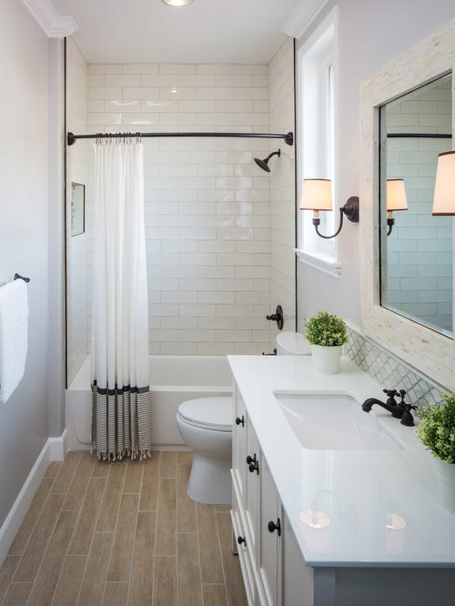 Large Transitional Stone Tile And White Tile Bathroom Idea In Los Angeles  With An Undermount Sink