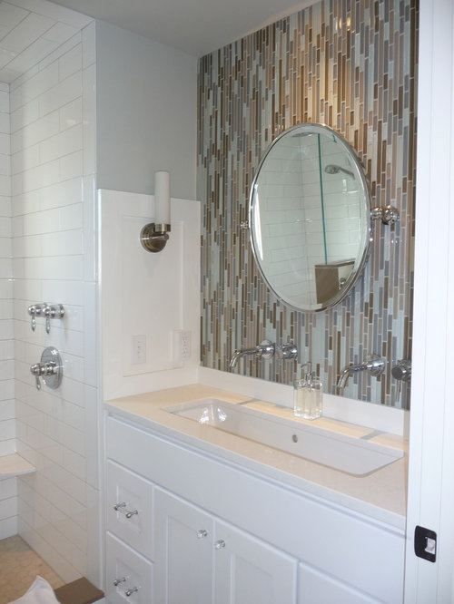 inspiration for a tile and matchstick tile bathroom remodel in with white cabinets