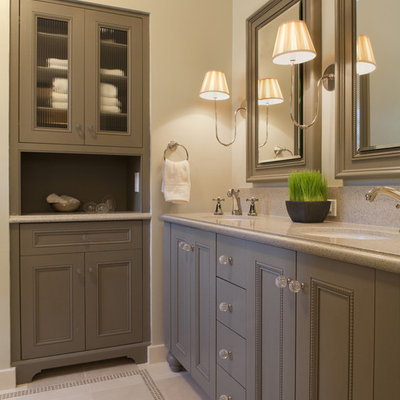 Elegant bathroom photo in San Francisco with brown cabinets