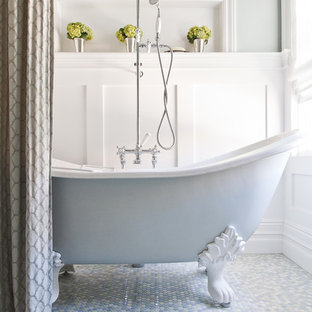 Example of a classic mosaic tile mosaic tile floor claw-foot bathtub design in San Francisco