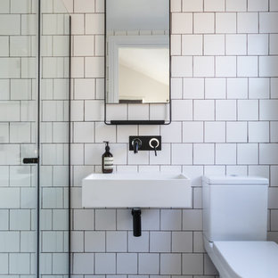 Design ideas for a classic shower room in London with an alcove shower, white tiles, white walls and concrete flooring.