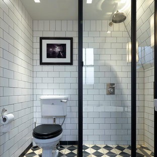 This is an example of a small victorian 3/4 wet room bathroom in London with a two-piece toilet, subway tile and an open shower.