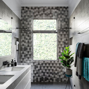 This is an example of a contemporary 3/4 bathroom in Melbourne with flat-panel cabinets, white cabinets, black tile, gray tile, white tile, an undermount sink and a double shower.