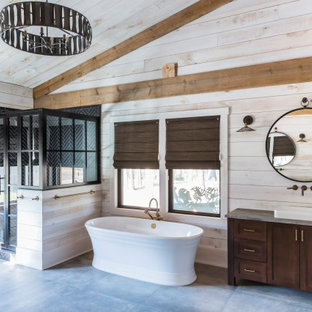 Example of a farmhouse gray floor, single-sink, vaulted ceiling and wood wall bathroom design in Raleigh with shaker cabinets, dark wood cabinets, beige walls, a drop-in sink, a hinged shower door, gray countertops and a freestanding vanity