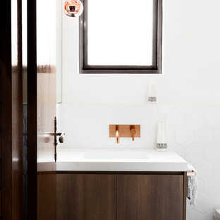 Mid-sized contemporary master bathroom in Melbourne with flat-panel cabinets, dark wood cabinets, white walls, a drop-in sink, multi-coloured floor, a drop-in tub, an alcove shower, a two-piece toilet, ceramic tile, ceramic floors, laminate benchtops, an open shower and white benchtops.