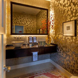 Small midcentury shower room in Dallas with flat-panel cabinets, dark wood cabinets, a one-piece toilet, grey tiles, metal tiles, multi-coloured walls, ceramic flooring, a vessel sink, wooden worktops and beige floors.