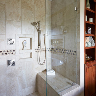 Inspiration for a large mediterranean master beige tile and porcelain tile porcelain floor and beige floor bathroom remodel in Seattle with furniture-like cabinets, medium tone wood cabinets, a two-piece toilet, beige walls, a vessel sink and solid surface countertops