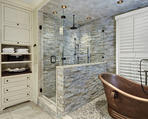 example of a stone tile and gray tile bathroom design in charleston with recessed