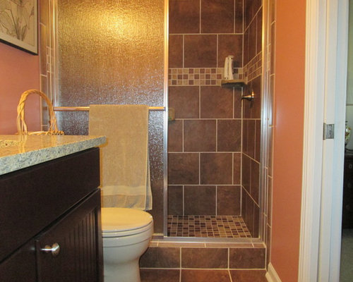 bathroom design ideas renovations photos with a two piece toilet and orange walls. Black Bedroom Furniture Sets. Home Design Ideas