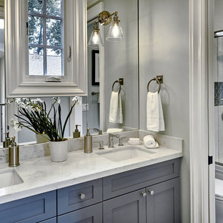 Inspiration for a medium sized mediterranean family bathroom in San Francisco with shaker cabinets, blue cabinets, an alcove bath, a corner shower, a two-piece toilet, white tiles, metro tiles, blue walls, porcelain flooring, a submerged sink, engineered stone worktops, grey floors, a sliding door and white worktops.