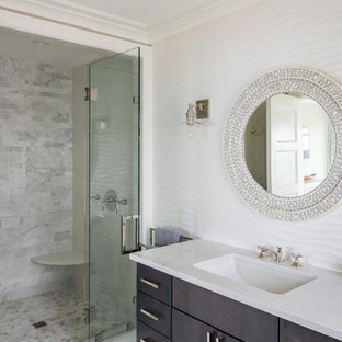 Mid-sized beach style kids' beige tile and limestone tile ceramic tile and multicolored floor alcove shower photo in New York with furniture-like cabinets, white cabinets, a one-piece toilet, beige walls, an undermount sink, quartzite countertops, a hinged shower door and white countertops