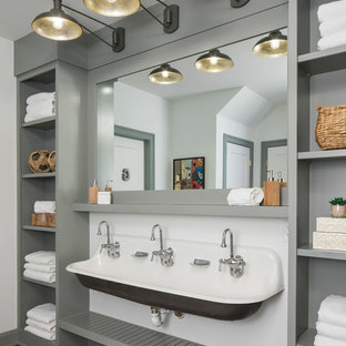 Inspiration for a large coastal family bathroom in Minneapolis with open cabinets, grey cabinets, white walls, a trough sink, concrete flooring, a built-in shower, a two-piece toilet, wooden worktops, grey floors and a hinged door.